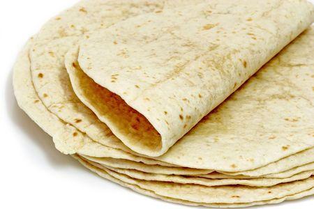 Tortilla flat bread on bright background Stock Photo