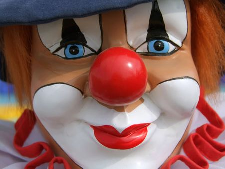 Portrait from a colorful clown doll as backround
