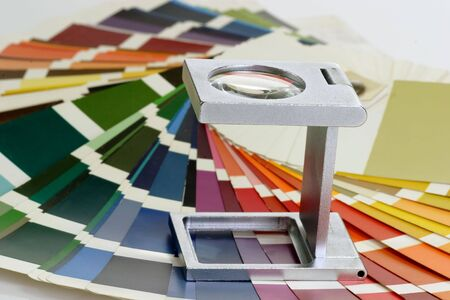 pre approval: Characteristic image for the pre-press and printing industry. Linen tester withand colour sample.