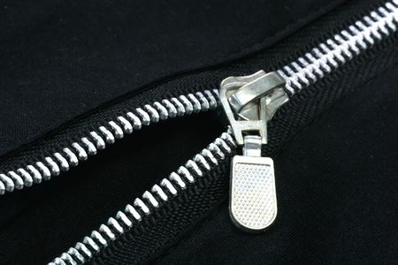 trouser: The zipper of a black trouser on a black background Stock Photo