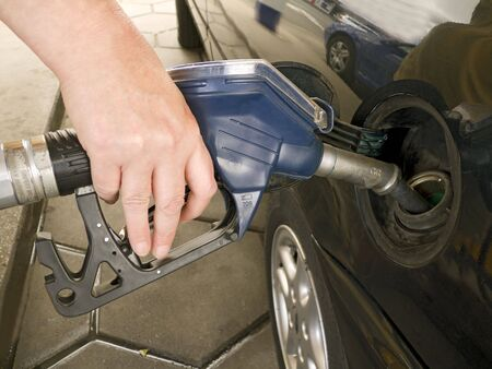 Hand on a fuel pump on a gas station Stock Photo - 3582103