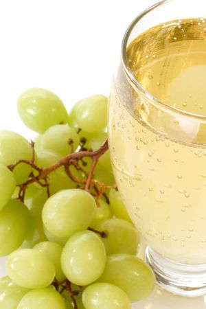 Spritzer in a glass with grapes on white background