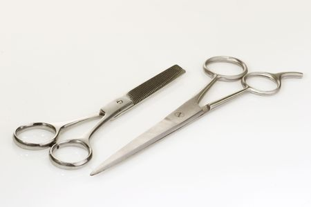 haircutting: Haircutting scissors on bright background