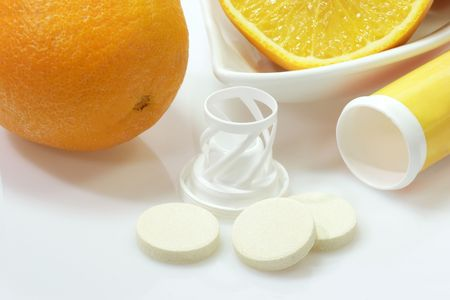 Effervescent tablets with plastic container on yellow background