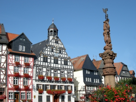 Historic building facades of Butzbach, Germany, with flowering window boxes, timber framing.