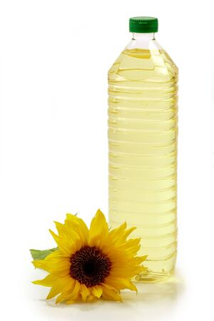 cooking oil: Cooking oil in a plastic bottle with sunflower on white background
