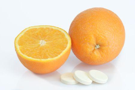 Large pills with orange fruits tube on bright background Stock Photo - 3851601