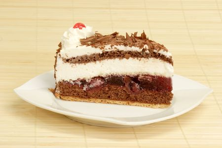 gateau: Slice from a delicious Black Forest gateau chocolate, cream and cherry cake.