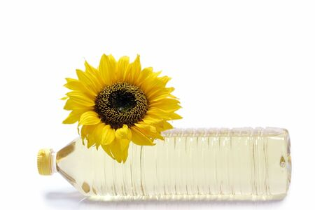 cooking oil: Sunflower with cooking oil bottle on white background