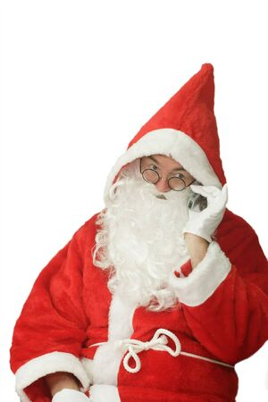 weihnachtsmann: Male caucasian model of santa claus calling on a cellphone - isolated on white background Stock Photo