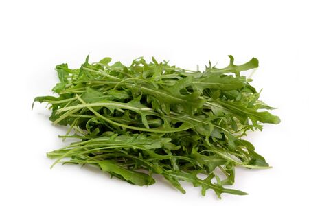 roquette: Fresh Rucola Salad on bright background Stock Photo