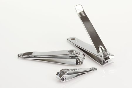 Silver nail clipper one bright background photo