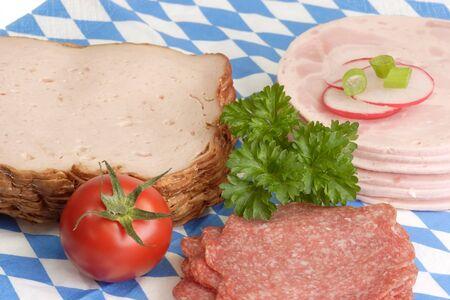 Fresh sliced sausage on bavarian napkin background Stock Photo - 3996113