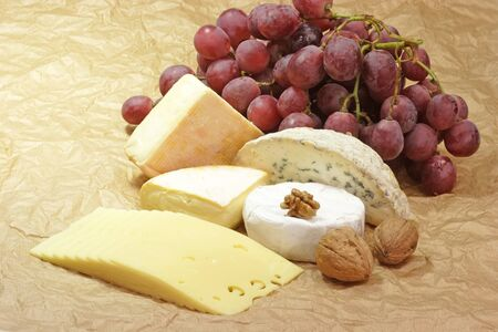 stillife: Stillife with cheese on brown background