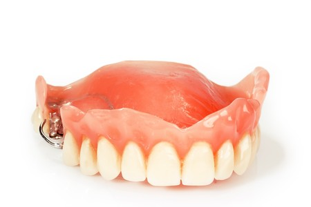 fix jaw: Dental prosthesis on bright background