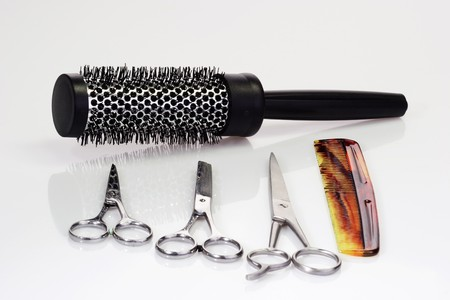 Haircutting tools on bright background Stock Photo - 4066972