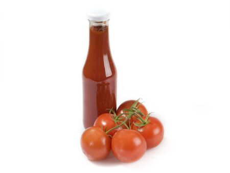 squirting ketchup: Tomato ingredients on white background Stock Photo
