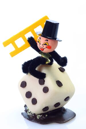 Marzipan chimney sweep with a dice on bright background Stock Photo - 4145945