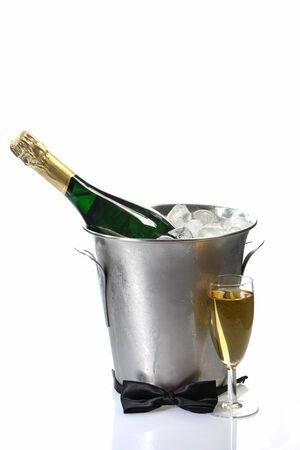 Champagne toast composition with bow tie on bright background photo