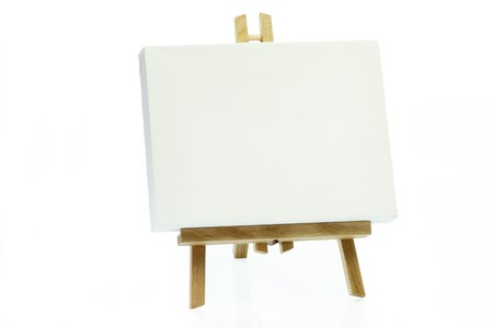 white canvas: Wooden art easel on bright background.