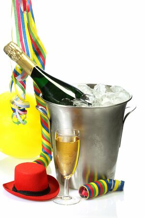 Champagne toast composition with streamers and carnival hat on bright background photo