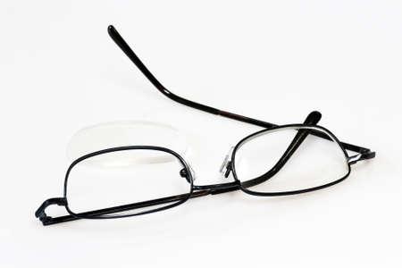 Broken eye glasses on bright background. Stock Photo - 4246293