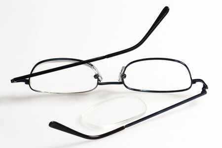 Broken eye glasses on bright background. Stock Photo - 4246472
