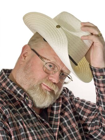 Man with cowboy hat looking. Shot in studio Stock Photo - 4325399