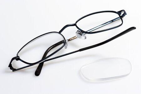 Broken eye glasses on bright background. Stock Photo - 4325935