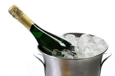 Champagne bottle in a cooler with ice on white background photo