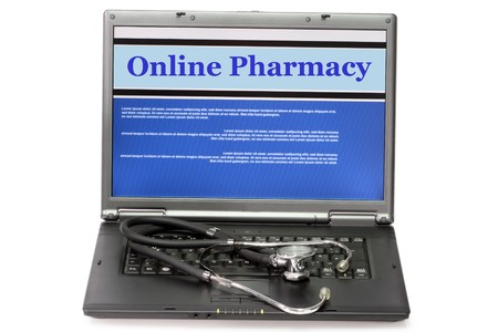 Online pharmacy- collage in laptop with stethoscope on white background Standard-Bild