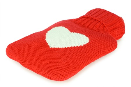 s stomach: Filled red hot water bottle. White background.