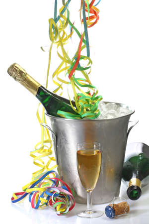 Champaigne bottle in a cooler with ice and new years eve decoration photo