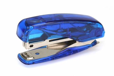 Office stapler on bright background  photo