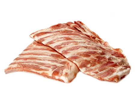 Raw spare ribs on white background