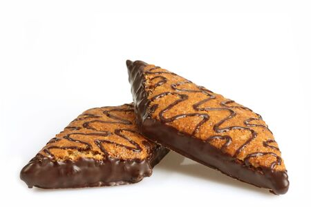 pices: Crunchy sweet nut snack with chocolate on bright background