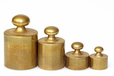 kilos: A set of lead weights isolated on whtie background  Stock Photo