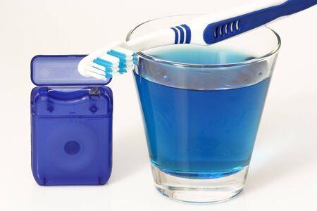 fluoride: Productos para el cuidado dental de fondo brillante