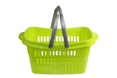 Green plastic shopping basket isolated on whtie background photo