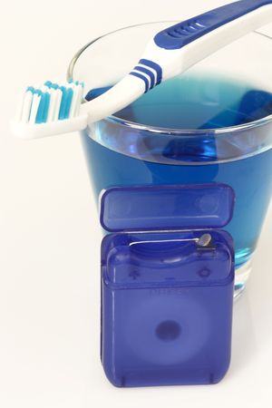Dental care products on bright background  photo
