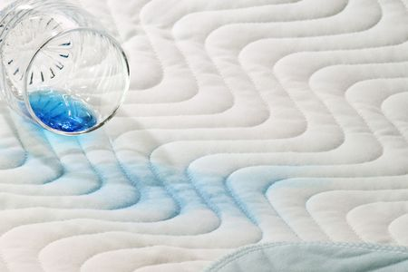 outpatient: Protection bed layer with a glass and blue fluid