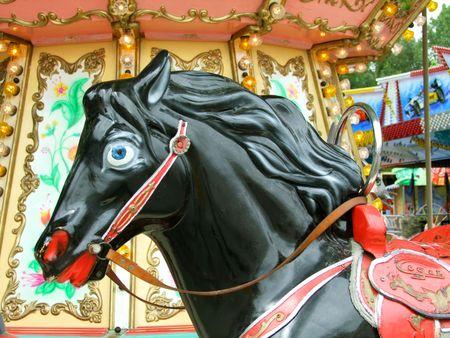 Black carnival carousel Horse. Shot outdoor photo