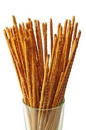 pretzel stick: Saltsticks in a glass on white background