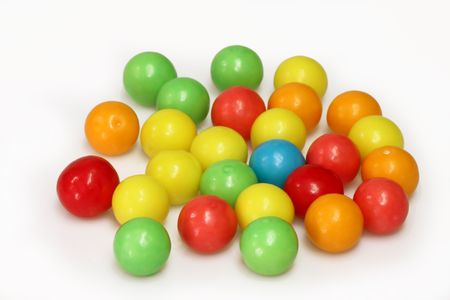 Chewing gum balls on white background photo