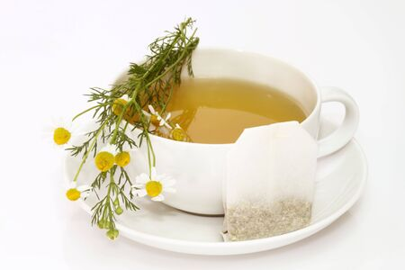 nontraditional: Herbal camomile tea on bright background