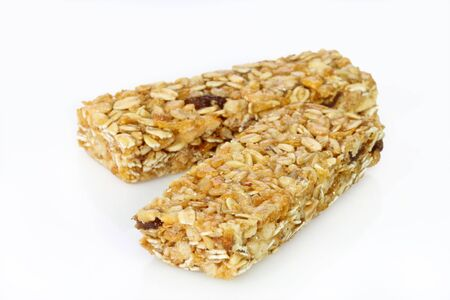Two cereal bars on a bright background photo