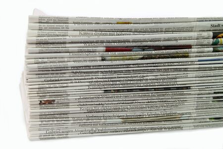 newsprint: German newspaper stack on white background