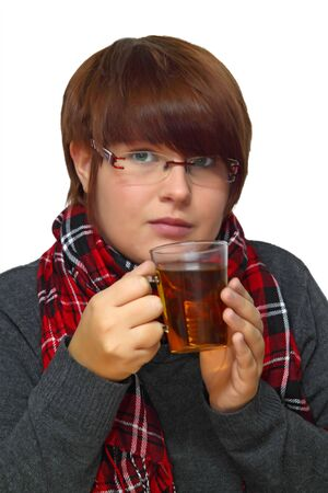 expectorant: Young woman drinking a herbal tea. Shot in studio.