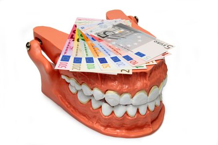 chomp: Plastic model of teeth isolated on white background Stock Photo