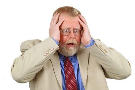 anguished: Ritratto di imprenditore in difficolt� con le mani sul suo viso, white background da vicino.